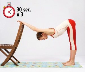 Downward dog stretch with chair or wall